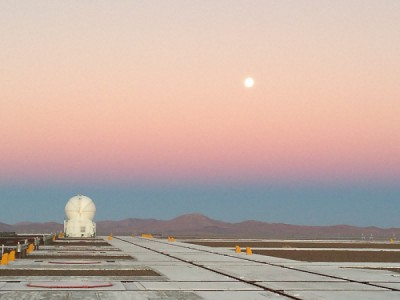 telescope in desert at sunset