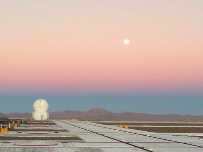 telescope in desert at sunset